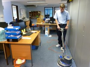 Man Cleaning Office Space Vaccum Cleaner