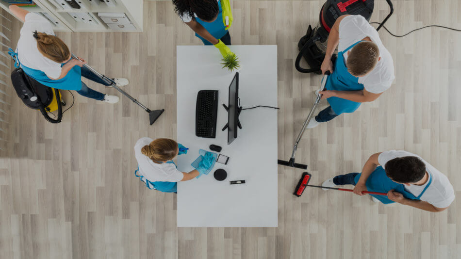 Commercial Cleaners Cleaning An Office