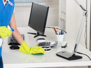 Office Desk Cleaning Gloves In Hands